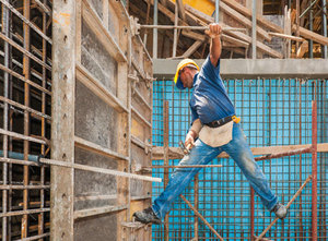 A scaffolder working with confidence knowing he has reliable Liability Insurance